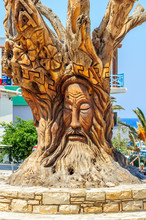 Famous Tree With Hippie Face In Matala, Crete