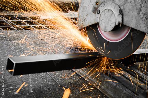 Obraz na plátně  Machines for metal cutting with sparks light