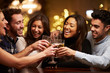 canvas print picture - Group Of Friends Enjoying Evening Drinks In Bar