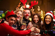 canvas print picture - Group Of Friends Enjoying Christmas Drinks In Bar
