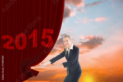 Fotografía  Composite image of businesswoman pulling a rope