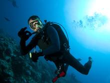 Scuba Diver Makes OK Sign Underwater