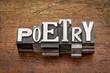 Leinwanddruck Bild - poetry word in metal type