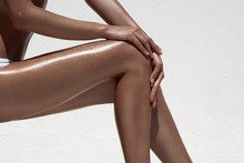 Beautiful Woman Tan Legs. Agai...