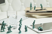 Miniature Warriors Are Fighting On The Office Desk