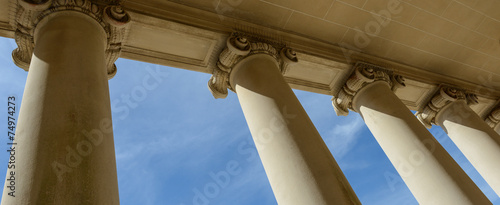 Photo Pillars of Law and Justice with Blue Sky