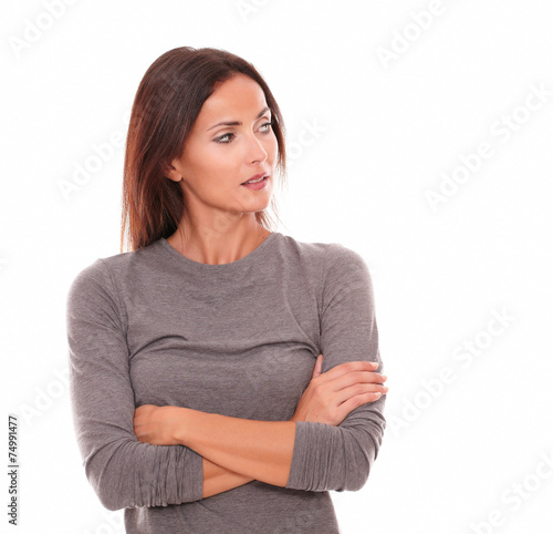 Unhappy female in grey blouse looking angry