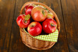 Wicker basket of red apples with green napkin