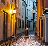 Fototapeta Uliczki - Narrow medieval street in old Riga city, Latvia, Europe