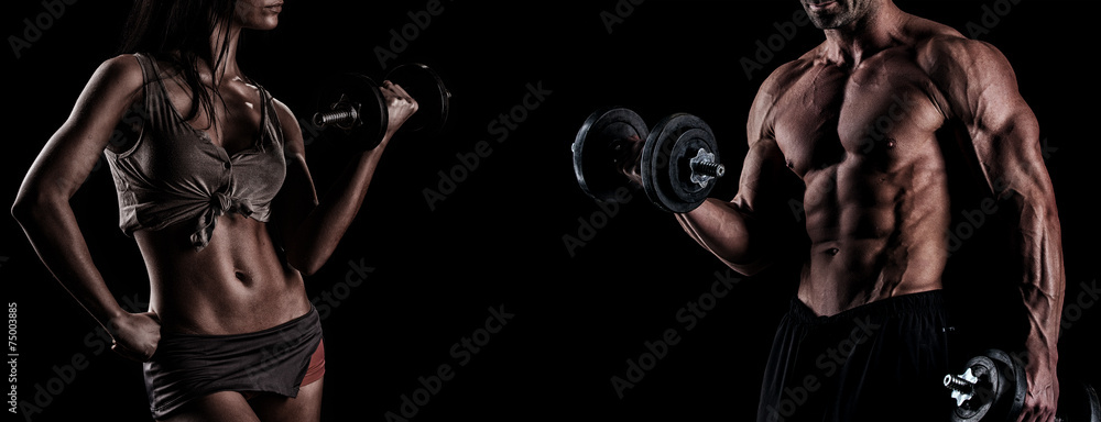Fototapety, obrazy: strong young couple working out with dumbbells. Shot in studio o