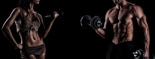 Fototapeta na wymiar strong young couple working out with dumbbells. Shot in studio o