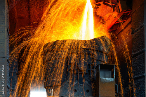 Valokuva  Smelting metal in a metallurgical plant.