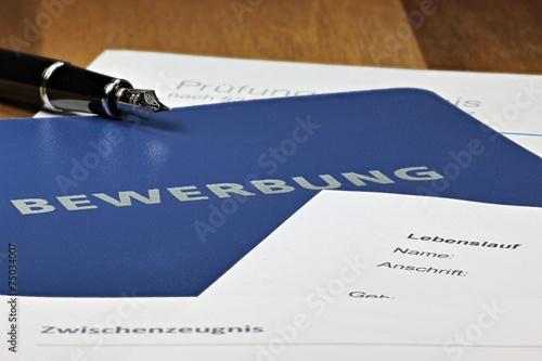 Fotografie, Obraz  Bewerbungsmappe auf Schreibtisch
