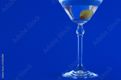martini on blue background плакат