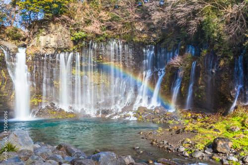 Fototapeten Forest river Shiraito no Taki waterfall with rainbow