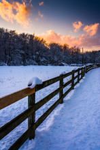 Fence On A Snow Covered Field At Sunset, In Rural York County, P