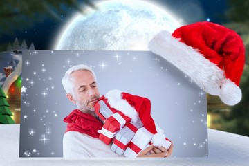 Composite image of happy festive man with gifts