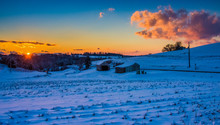 Sunset Over A Snow Covered Farm Field In Rural York County, Penn
