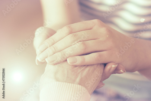 Photo  Helping hands, care for the elderly concept