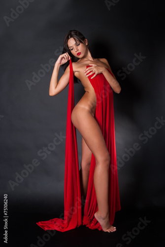 Nude body covered with a reb fabric