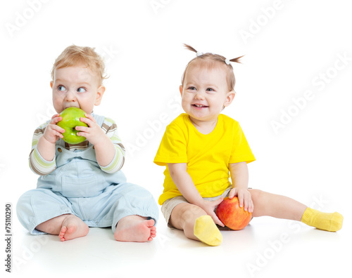Photo Stands Grocery Baby boy and girl eating apples isolated