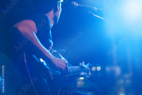 Fotografía  Guitarist on stage for background, soft and blur concept