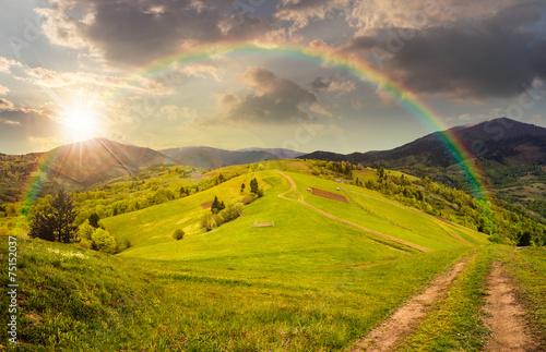 Spoed Fotobehang Rijstvelden fence on hillside meadow in mountain at sunset