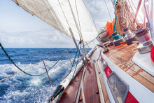 Sail Boat Navigating On The Waves