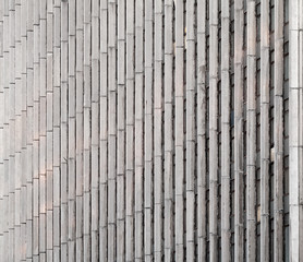 Concrete wall with vertical lines and windows