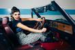 Pinup in vintage car