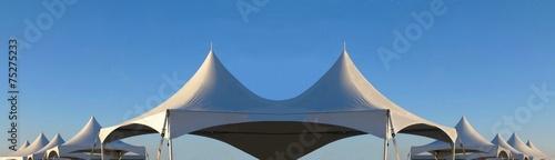 Fototapeta row of white tent tops obraz