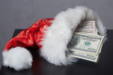 Money In A Christmas Cap Santa...