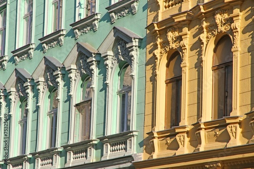 Papiers peints Con. Antique decorated facade of an ancient building with Windows