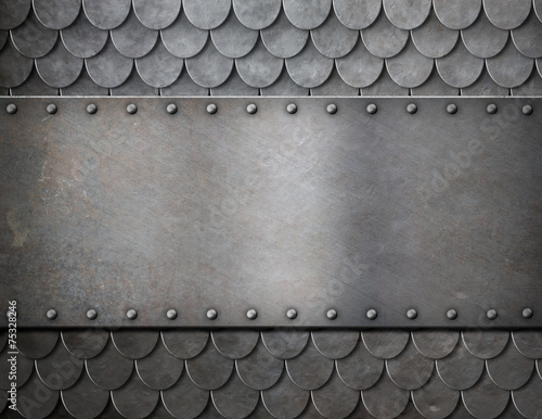 Photo metal plate over scales armor background