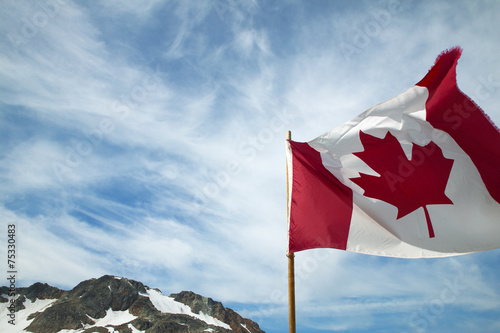 Fotobehang Canada Canadian flag with sky background. British Columbia. Canada