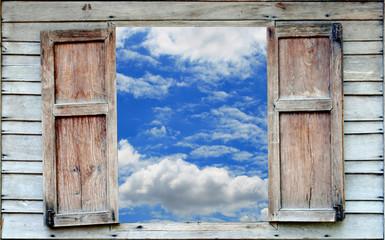 Fototapetablue sky and old wood window