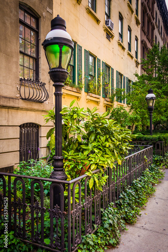 Photo  Gardens and townhouses along 23rd Street in Chelsea, Manhattan,