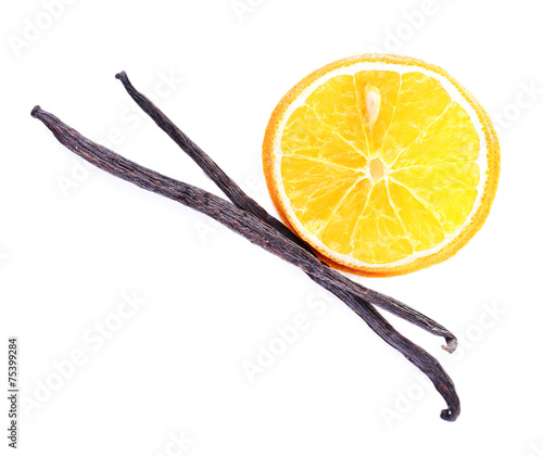 Dried orange with vanilla beans isolated on white Wall mural