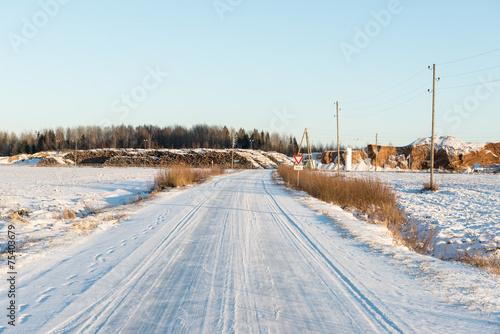 Fotobehang Lichtblauw country snowy road in winter