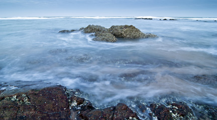 Beautiful seascape and rock in slow shutter speed