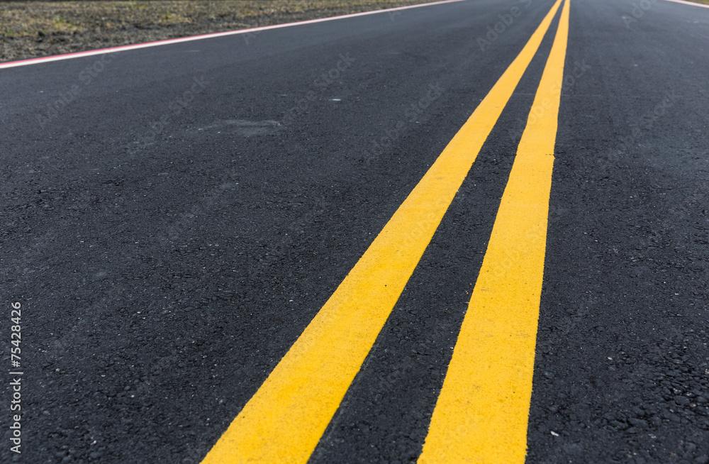 Fototapeta Asphalt road with pair of yellow line