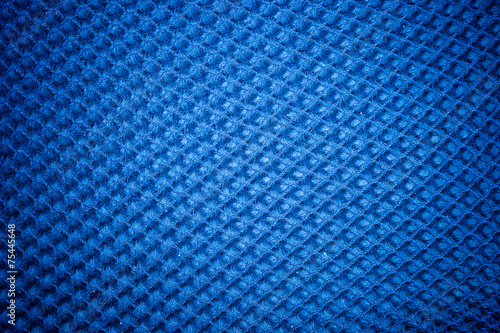 Fotografie, Obraz  A vintage cloth cover with a blue screen pattern and grunge back