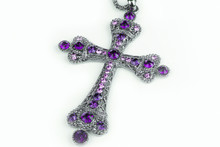 Purple Cross Necklace In A Stu...