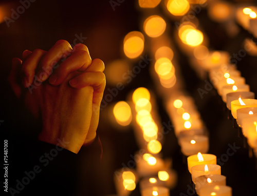Praying in catholic church. Religion concept.