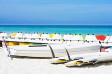 Colorful Pedalos Docked At The Shore Of The Tropical Beach Of Sa