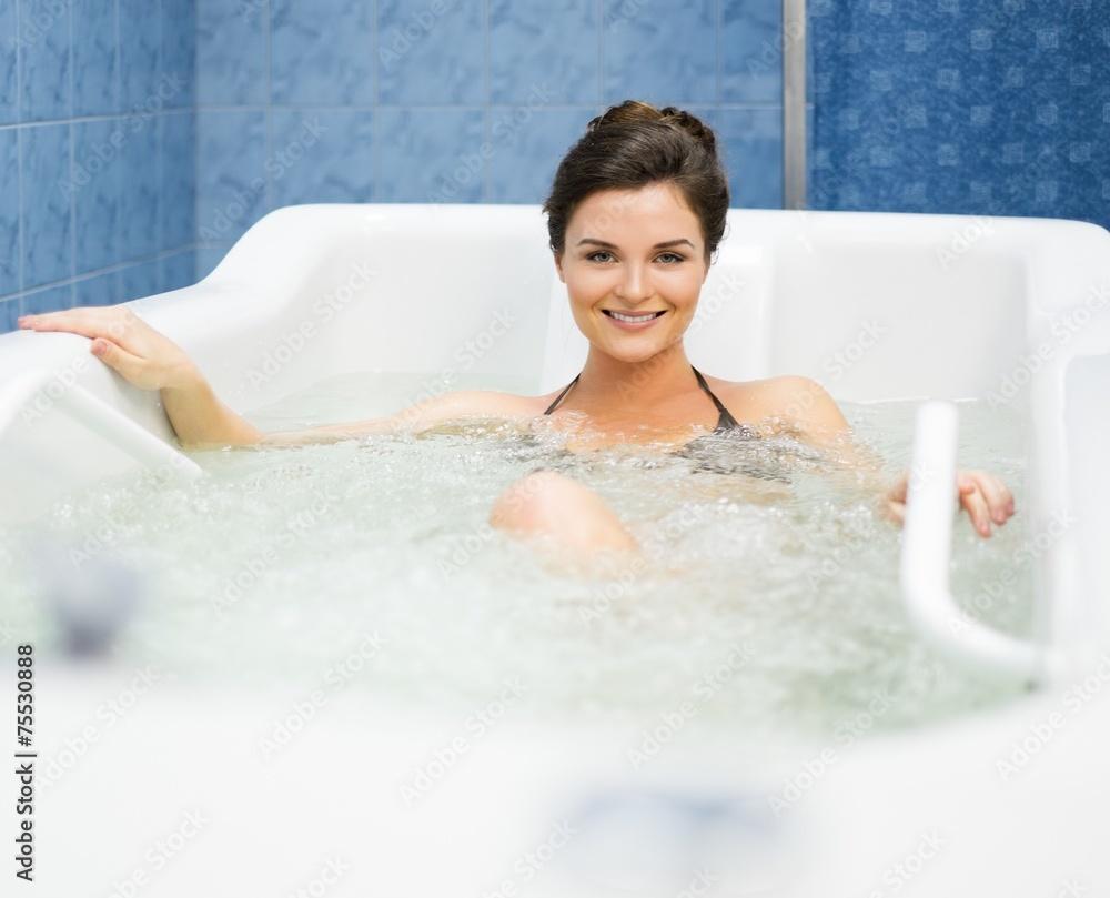 Fototapeta Woman having procedure in a  bathtub