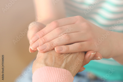 Obraz Helping hands, care for the elderly concept - fototapety do salonu