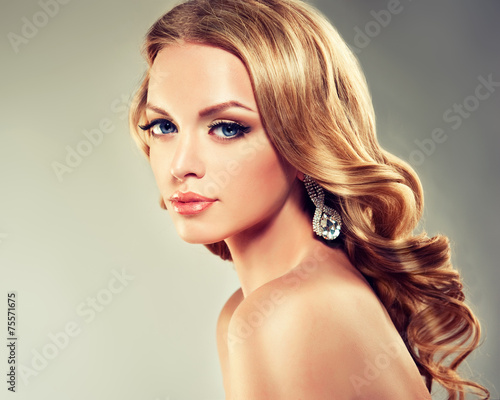 Fotografie, Obraz  Beautiful model blond with curly hair and fashion earings
