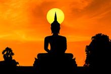 Silhouette Big Buddha Statue Sitting On Sunset
