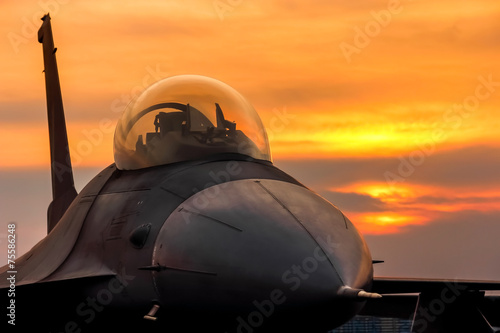 f16-falcon-fighter-jet-on-sunset-background